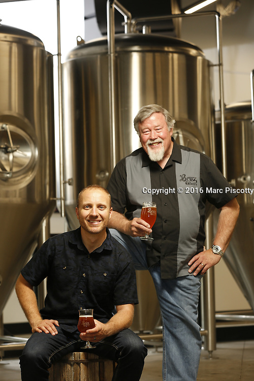 SHOT 7/22/16 2:14:11 PM - Bruz Beers co-founders Charlie Gottenkieny and Ryan Evans inside the new brewery near 67th Avenue and Pecos in Denver, Co. Bruz Beers is Denver's artisanal Belgian-style brewery, featuring a full line of traditional and Belgian-inspired brews, hand-crafted in small batches. Includes images of Evan's dog 'Cooper' as well who serves as the brewery dog. (Photo by Marc Piscotty / © 2016)