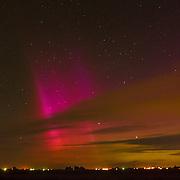 Green, orange, purple and red Aurora Borealis fill the sky in southwest Idaho
