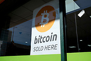 Bitcoin sold here sign in a small shop window in Birmingham, United Kingdom. Bitcoin is a cryptocurrency. It is a decentralized digital currency without a central bank or single administrator that can be sent from user to user on the peer-to-peer bitcoin network without the need for intermediaries.