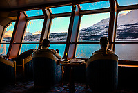 View from the Panoramic lounge on the Hurtigruten ship MS Nordlys nearing Tromso, Arctic, Northern Norway.