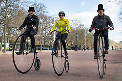 © Licensed to London News Pictures. 11/04/2021. London, UK. Members of the public ride Penny Farthing Bicycles on the The Mall in central London during sunny conditions. Temperatures are expected to rise with highs of 15 degrees forecasted for parts of London and South East England later this week . Photo credit: George Cracknell Wright/LNP