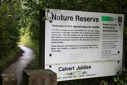 A sign indicates the entrance to Calvert Jubilee Nature Reserve on 27 July 2020 in Calvert, United Kingdom. On 22nd July, the Berks, Bucks and Oxon Wildlife Trust (BBOWT) reported that it had been informed of HS2's intention to take possession of part of Calvert Jubilee nature reserve, which is home to bittern, breeding tern and some of the UK's rarest butterflies, on 28th July to undertake unspecified clearance works in connection with the high-speed rail link.