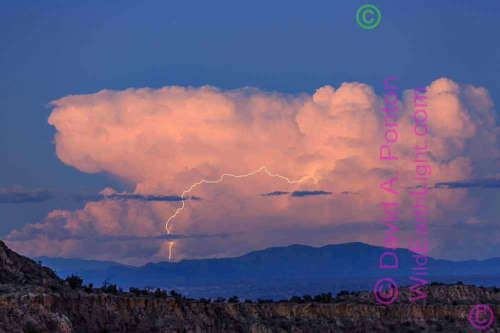 Lightning storm with miles-long lightning bolt above the Sangre de Cristo Mountains near Taos, NM, viewed from the Jemez Mountains, © David A. Ponton, [Prints to 8x12, 16x24, 24x36 or 40x60 in. with no cropping]