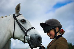 © Licensed to London News Pictures.29/08/15<br /> Bilsdale, UK. <br /> <br /> A rider stands with her horse during the 105th Bilsdale Country Show in North Yorkshire.<br /> <br /> Photo credit : Ian Forsyth/LNP