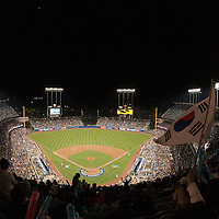 23 March 2009: A fan of team Korea waives a flag during the 8th inning during the 2009 World Baseball Classic final game at Dodger Stadium in Los Angeles, California, USA. Japan defeated Korea 5-3
