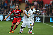 Laurent Depoitre of Huddersfield Town challenges Jordan Ayew of Swansea city ®.Premier league match, Swansea city v Huddersfield Town at the Liberty Stadium in Swansea, South Wales on Saturday 14th October 2017.<br /> pic by  Andrew Orchard, Andrew Orchard sports photography.