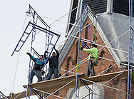 Workers from New York Ladder & Scaffold of Yonker erect scaffolding high on the First Congregational Church in Middletown on Thursday, March 21, 2013. The church sustsained roof and steeple damage from Hurricane Sandy. The steeple will be reshingled and part of the roof repaired.