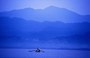Fishing at dawn in Gumacas bay with the Sierra Madre mountain range visible in the background, Aurora, Philippines