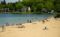 Beach goers at Weirs Beach on Wednesday as the temperature rises above 90 degrees.  (Karen Bobotas/for the Laconia Daily Sun)