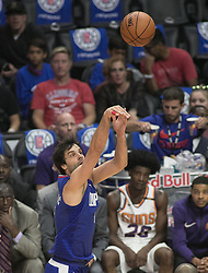 October 21, 2017 - Los Angeles, California, U.S - Milos Teodosic #4 of the Los Angeles Clippers takes a shot during their first regular season game against the Phoenix Suns on Saturday October 21, 2017 at the Staples Center in Los Angeles, California. Clippers defeat Suns, 130-88. (Credit Image: © Prensa Internacional via ZUMA Wire)