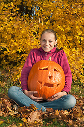 Girl holding halloween lantern, smiling, portrait