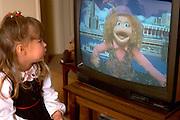 Preschooler age 5 watching Sesame Street television show.  WesternSprings  Illinois USA