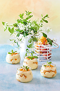Bowls with fresh apricot tiramisu on a table with jasmine flowers.<br /> EXCLUSIVE ONLY ON THIS SITE!