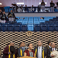 011315       Cable Hoover<br /> <br /> Newly inaugurated council delegates stand behind emcee Jocelyn Billy-Upshaw during a ceremony at Window Rock High School Tuesday.