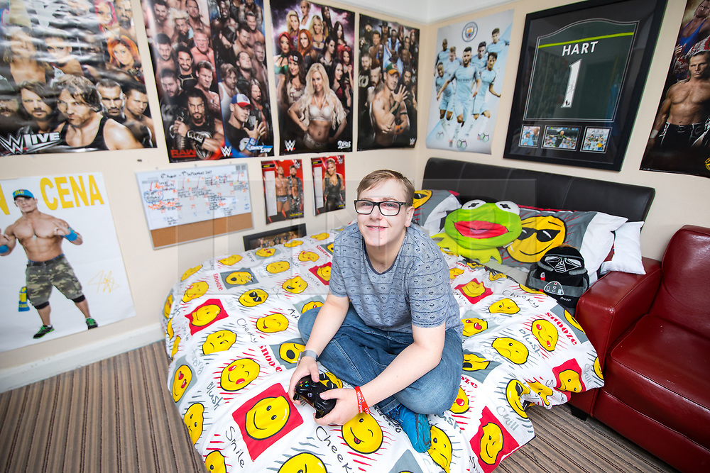 © Licensed to London News Pictures . 12/08/2017 . Manchester , UK . CONNOR SHAW (17 - turns 18 today - 13/08/2017) in his bedroom at home ahead of his birthday . When he was born doctors said he wouldn't live long due to a heart condition but he's doing well after receiving expert care , multiple operations and a heart transplant . His parents are campaigning for an opt-out organ donor register . See http://www.manchestereveningnews.co.uk/news/greater-manchester-news/never-thought-son-would-reach-13469965 for more information . Photo credit : Joel Goodman/LNP