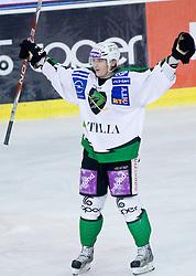 Tomi Mustonen (HDD Tilia Olimpija, #21) during ice-hockey match between HDD Tilia Olimpija and EHC Liwest Black Wings Linz in 37th Round of EBEL league, on Januar 9, 2011 at Hala Tivoli, Ljubljana, Slovenia. (Photo By Matic Klansek Velej / Sportida.com)