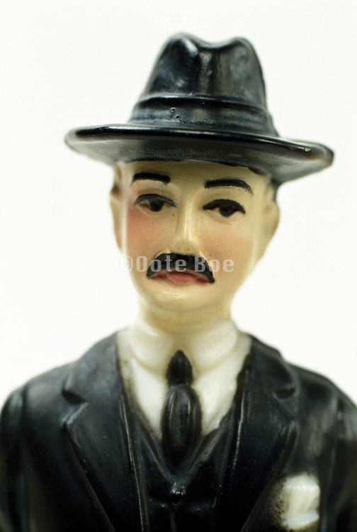 figurine of man in hat and suit