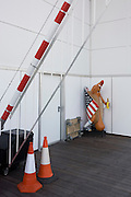Away from public view, a Hot Dog cartoon character stands around the back of the new Weston-super-Mare pier.