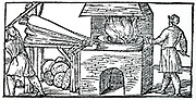 Using bellows to increase draught in furnace for refining copper. Note cupellation cakes of partially refined copper beneath the bellows. From Vannocio Biringuccio 'De la Pirotechnia', Venice 1540.