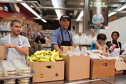 President Barack Obama helps pack food donation bags at Food & Friends as part of the National Day of Remembrance and Service in Washington, DC, USA, on September 11, 2013. Obama volunteered his time on the 12th Anniversary of the terrorist attacks on 9/11. Photo by Kevin Dietsch/UPI/Pool/ABACAPRESS.COM    413855_005 Washington Etats-Unis United States