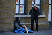 Homeless people in the United Kingdom facing the risk of death from Coronavirus. Last years alone, 320,000 people were recorded as homeless in Britain, analysis from housing charity Shelter suggests. It is a rise of 13,000, or 4%, on last year's figures and equivalent to 36 new people becoming homeless every day.<br /> In this picture, a homeless man is seating at the entry of London Bridge overground station on Sunday, March 22, 2020. For most people, the new coronavirus causes only mild or moderate symptoms, such as fever and cough. For some, especially older adults and people with existing health problems, it can cause more severe illness, including pneumonia. <br /> (Photo/Vudi Xhymshiti)