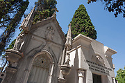 Individual tombs and family mausoleums, on 14th July 2016, at Prazeres Cemetery, Lisbon, Portugal. Prazeres Cemetery Cemitério dos Prazeres is the largest cemetery in Lisbon, Portugal, located in the west part of the city in the former Prazeres parish. It was created in 1833 after the outbreak of a cholera epidemic. Many famous Portuguese citizens are buried here, including artists, authors and government figures, and the cemetery features many large mausoleums built in the 19th century.
