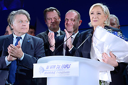 Far-right National Front leader Marine Le Pen, along with FN MP Gilbert Collard and he city's mayor Steve Briois, addresses activists at the Espace Francois Mitterrand on April 23, 2017, in Henin-Beaumont, north of France. Le Pen will face centrist leader Emmanuel Macron in a run-off for the French presidency on 7 May, near-final results show. With 96% of votes counted from Sunday's first round, Mr Macron has 23.9% with Ms Le Pen on 21.4%. Photo by Aurore Marechal/ABACAPRESS.COM