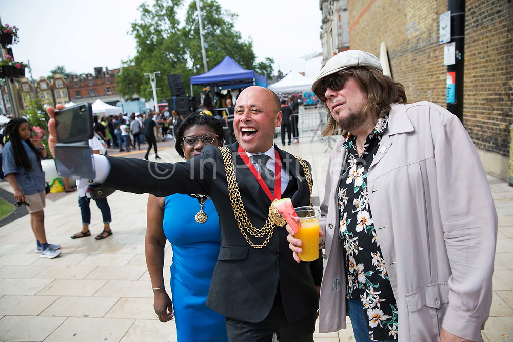 Councillor Christopher Wellbelove, Mayor of Lambeth with Emita Griffith and Jerry Dammers, founder, keyboard player and primary songwriter of ska revival band The Specials during the Windrush70 celebration on the 23rd June 2018 in Brixton in the United Kingdom. (photo by Sam Mellish / In Pictures via Getty Images)