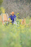 Artist painting the view of the ancient Chinese Xidi village, UNESCO World heritage, Anhui province, China