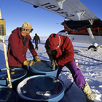ANTARCTICA. Aerial reconnaissance expedition to Queen Maud Land refuels from cache near Vahsel Bay, where Jet A costs more than Scotch whisky.