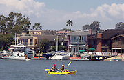Couple Kayaking In Newport Harbor