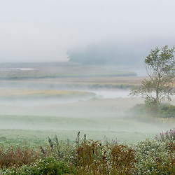The York River winds through fog, fields, and salt marsh in York, Maine.