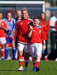 YSTRAD MYNACH, WALES - Wednesday, April 5, 2017: Wales' Jessica Fishlock walks out with her nephew to a guard of honour to mark her 100th appearance ahead of the Women's International Friendly match against Northern Ireland at Ystrad Mynach. (Pic by Laura Malkin/Propaganda)