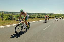 21.06.2014, Remich, LUX, Ergo Ironman 70.3, im Bild Marino Vanhoenacker (amptierender Triathlon Europameister, Belgium) auf der Radstrecke mit einem Schatten, der wie ein Teufel aussieht // during the Ergo Ironman 70.3 in Remich, Luxembourg on 2014/06/21. EXPA Pictures © 2014, PhotoCredit: EXPA/ Eibner-Pressefoto/ Schueler<br /> <br /> *****ATTENTION - OUT of GER*****