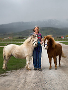 Anpeytu Neier with her future therapy mini horses Gandalf and Merlin in Star Valley, Wyoming on Monday, May 13, 2019.