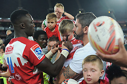 070418 Emirates Airlines Park, Ellis Park, Johannesburg, South Africa. Super Rugby. Lions vs Stormers. Man of the match Madosh Tambwe signs a young boys shirt during a meet and greet after the game before embarking on the Lions away tour.<br />Picture: Karen Sandison/African News Agency (ANA)
