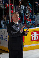 KELOWNA, CANADA - APRIL 25: Ron Robison, Commissioner of the Western Hockey League, stands on the ice to present the Western Conference trophy to the Portland Winterhawks on April 25, 2014 during Game 5 of the third round of WHL Playoffs at Prospera Place in Kelowna, British Columbia, Canada. The Portland Winterhawks won 7 - 3 and took the Western Conference Championship for the fourth year in a row earning them a place in the WHL final.  (Photo by Marissa Baecker/Getty Images)  *** Local Caption *** Ron Robison;