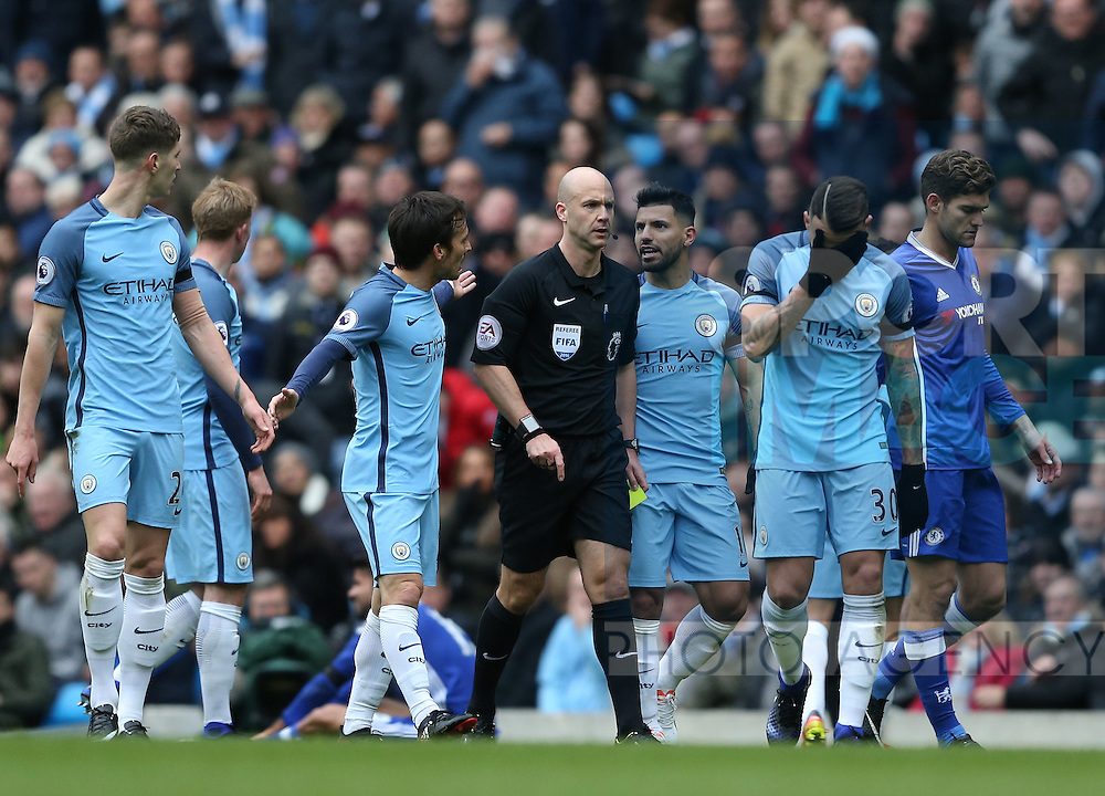 City players confront referee Anthony Taylor during the Premier League match at the Etihad Stadium, Manchester. Picture date: December 3rd, 2016. Pic Simon Bellis/Sportimage