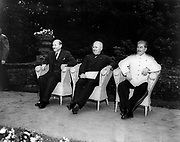 Clement Attlee, Harry Truman, and Joseph Stalin, seated outdoors at the Potsdam (Berlin) conference in 1945