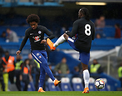 """Chelsea's Willian (left) and Victor Moses wearing the shirt number """"8"""" on their pre-match training shirts in memory of the late Ray Wilkins"""
