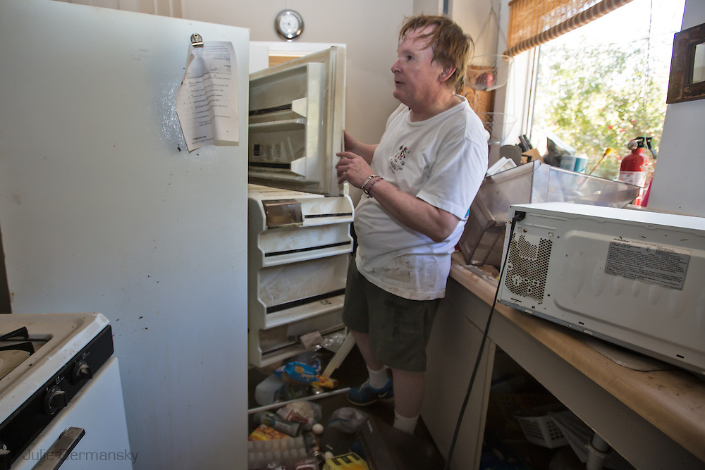 Goobee Louisiana, March, 12, 2016, Walter Unglaub returns to his residence that  was inundated with water the day before. 14 inches of rain fell in less than 24 hours, after three days of intermittent rain, causing flash floods. The Tchefuncte River  and Bogue Falaya River<br />  crested on Saturday morning but the flood event continued into the night for those in Tallow Creek.