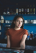 Bacalar, Mexico - June 3, 2021: Portrait of Isabel Fernandez, 21, at work behind the bar at the Yak Lake House in Bacalar