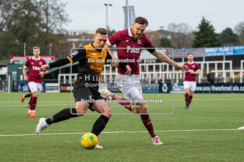 BROMLEY, UK - DECEMBER 07: Joseph Taylor, of Cray Wanderers FC, crosses the ball to set the first goal up during the BetVictor Isthmian Premier League match between Cray Wanderers and Potters Bar Town at Hayes Lane on December 7, 2019 in Bromley, UK. <br /> (Photo: Jon Hilliger)