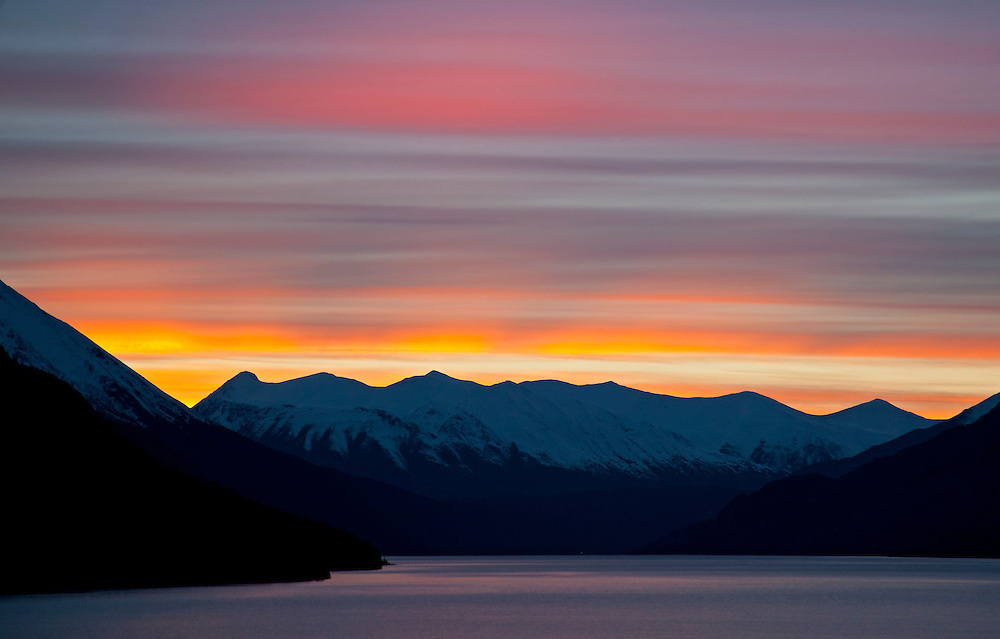 Alaska. Stratus clouds layers make for this dramatic effect at sunset over Turnagain Arm, Cook Inlet.