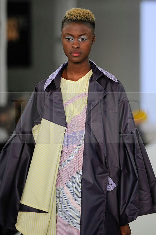 © Licensed to London News Pictures. 05/06/2017. London, UK. A model presents a look by Emma Hance from The Arts University Bournemouth on the second day of Graduate Fashion Week taking place at the Old Truman Brewery in East London.  The event showcases the graduation show of up and coming fashion designers from UK and international universities. Photo credit : Stephen Chung/LNP