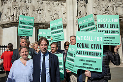© Licensed to London News Pictures. 14/05/2018. London, UK. Rebecca Steinfeld (L) and Charles Keidan (2_L) arrive at the Supreme Court where they seek a change in the law that will allow heterosexual couples to enter into civil partnerships. Steinfeld and Keidan, who have 'deep-rooted' ideological objections to the institution of marriage, have previously lost their case at the High Court and the Court of Appeal. Photo credit: Rob Pinney/LNP
