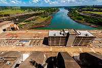 The hydraulic pistons and servomotors open and close to control the water intake gates to control the flow from the Itaupu Dam to the 20 turbines inside the hydroelectric power plant. Brazil/Paraguay border.