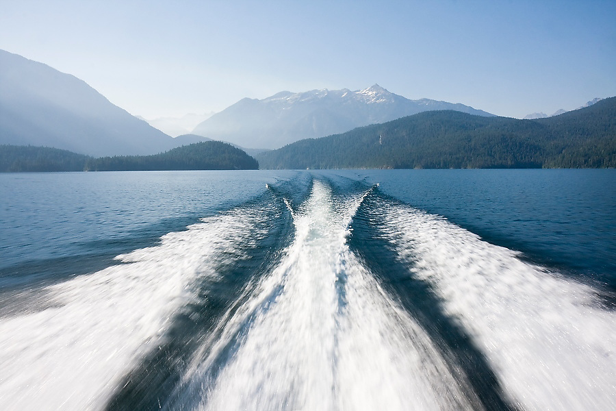 The Ross Lake Resort water taxi leaves a wake as it speeds up Ross Lake to drop off climbers at Little Beaver Trailhead, access to the remote Northern Pickets Range in North Cascades National Park, Washington.