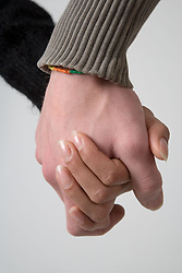 Portrait of a young couple holding hands,