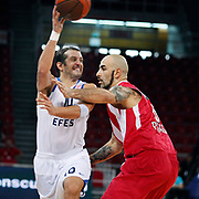 Anadolu Efes's Kerem TUNCERI (L) and Olympiacos's Pero ANTIC (R) during their Two Nations Cup basketball match Anadolu Efes between Olympiacos at Abdi Ipekci Arena in Istanbul Turkey on Sunday 02 October 2011. Photo by TURKPIX